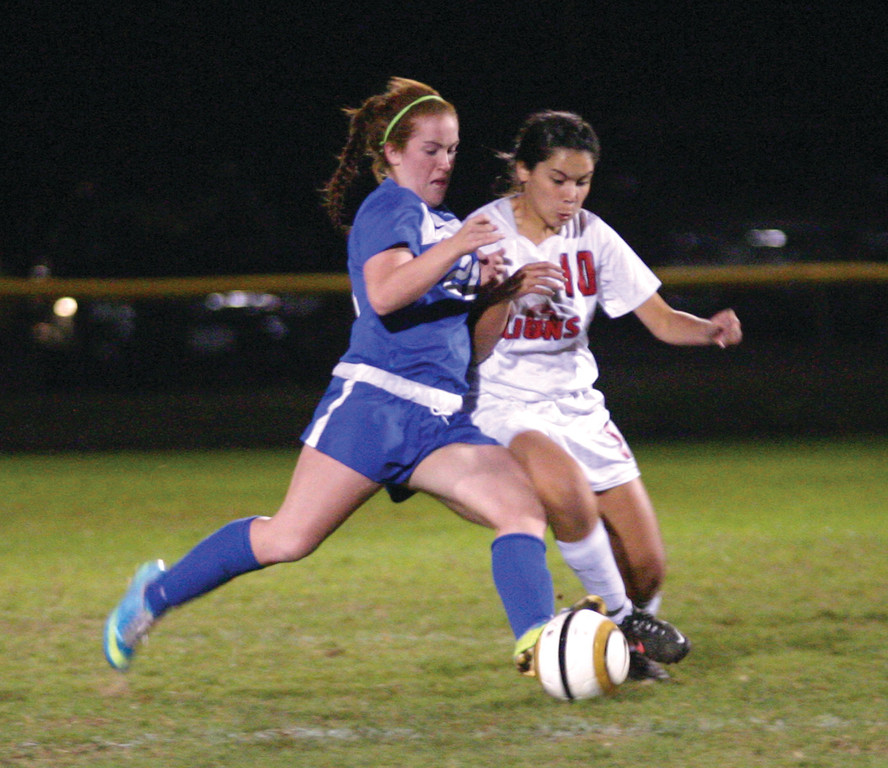 Elizabeth Gemmell fights for possession.