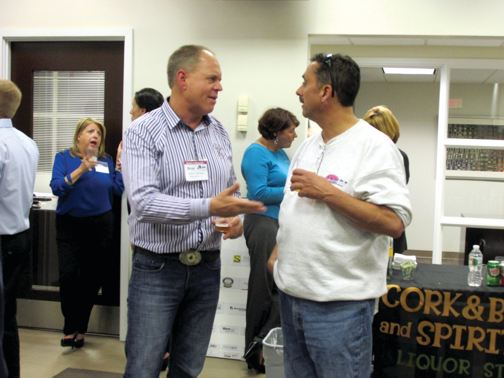 AT AFTER HOURS: Arrest-A-Pest, Inc. President Brent Wyrostek (left) chats with Shawn Lynch, owner of Lynch
