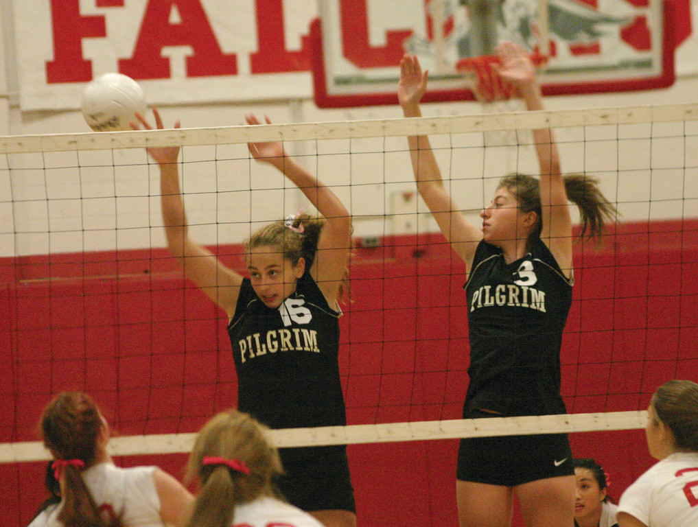 DOUBLE TEAM: Tayla Ferreira and Alexa Annotti try to put up a block in Monday