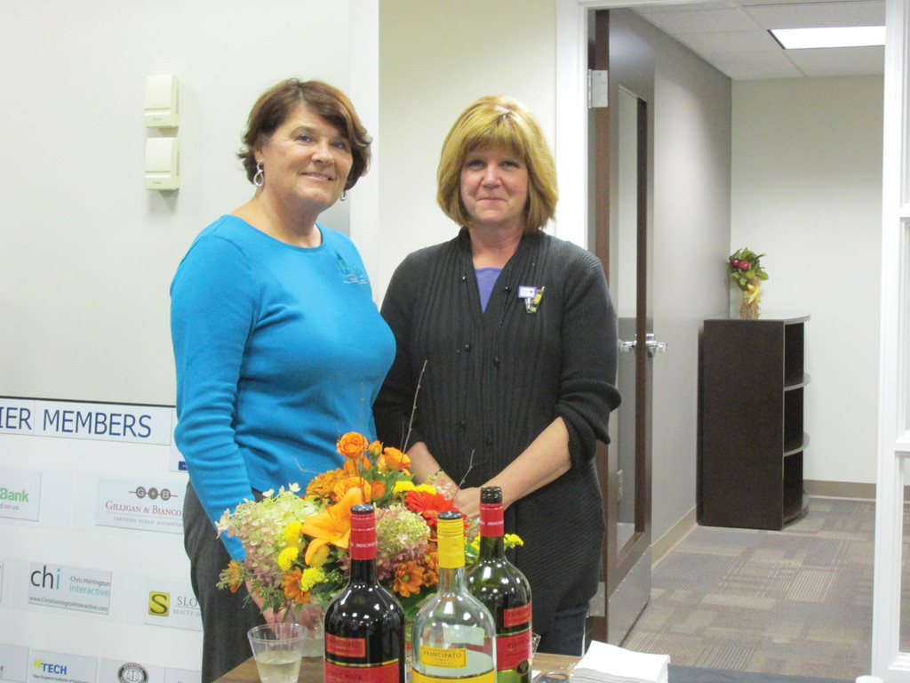 IN THE SPIRIT: Central RI Chamber Sales and Marketing Director Chris Allen (left) enjoys a lighter moment with Shelley Maezes of Cork & Brew and Spirits too during last week