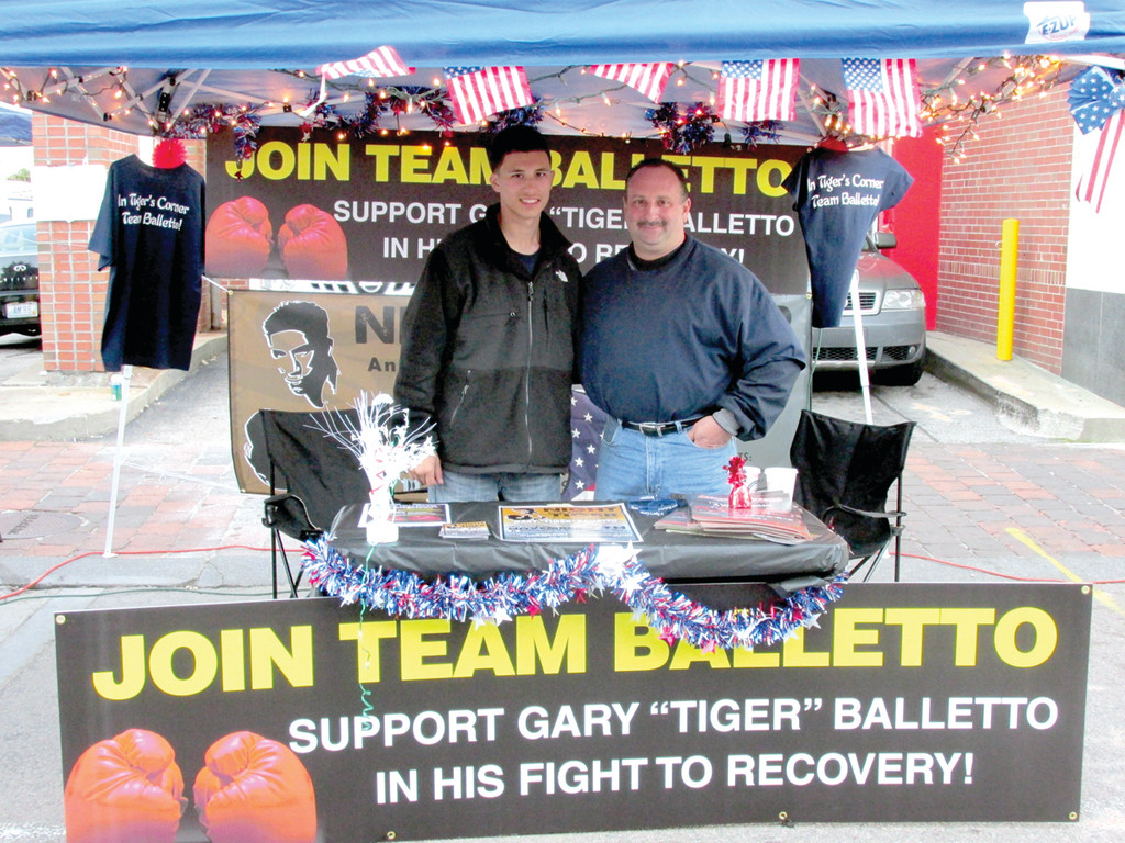 Johnston resident and business owner George Arakelian Jr. (right) and his son, George III, manned this booth in the Columbus Day Festival on Federal Hill with his wife Gina Sabitoni-Arakelian and daughter Gianna to sell bracelets and raise money for Team Balletto that