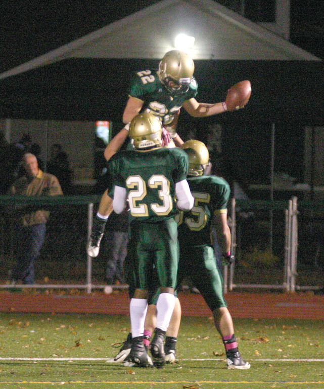 ANOTHER SCORE: Hendricken's Remington Blue is lifted skyward by teammates following a touchdown in Friday's win over Portsmouth. Blue rushed for 168 yards and four touchdowns on just six carries. The senior has scored 18 touchdowns this season.