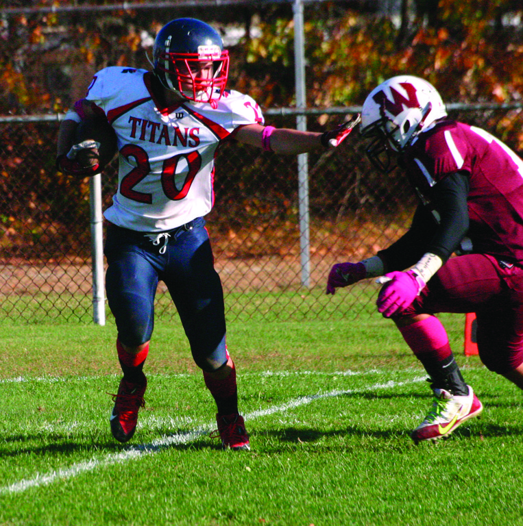 HOLDING THEIR OWN: Josh Thibeault stiff-arms a Woonsocket defender on Saturday.