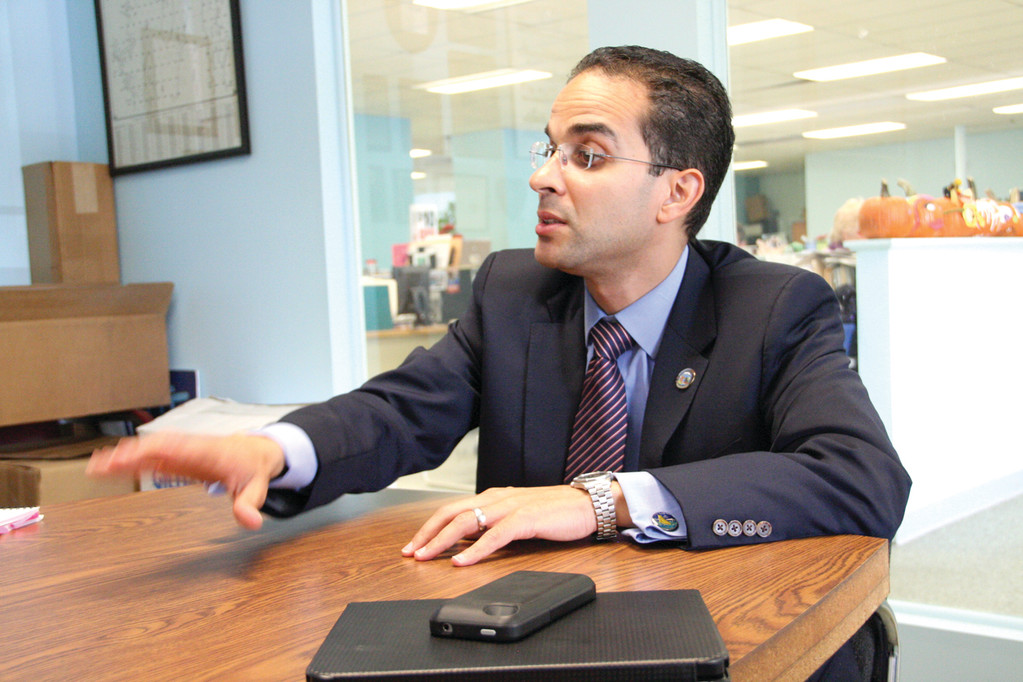 MAKING A POINT: Providence Mayor and Democratic candidate for governor, Angel Taveras talked with reporters Tuesday at Warwick Beacon offices.