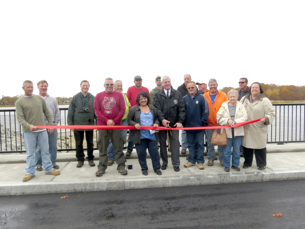 DANGER NO MORE: The workers from the Warwick Department of Public Works, along with Warwick Mayor Scott Avedisian, City Council President Donna Travis, and Department of Public Works Director Dave Picozzi, celebrated the official completion of Danger Bridge in Oakland Beach on Friday afternoon. Travis and Avedisian both thanked the workers for their time completing the bridge, on schedule and under budget.