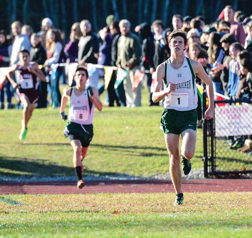 RUNNING TO HISTORY: Colin Tierney (right) heads for the finish in front of teammate Michael Potter at Sunday�s state meet.