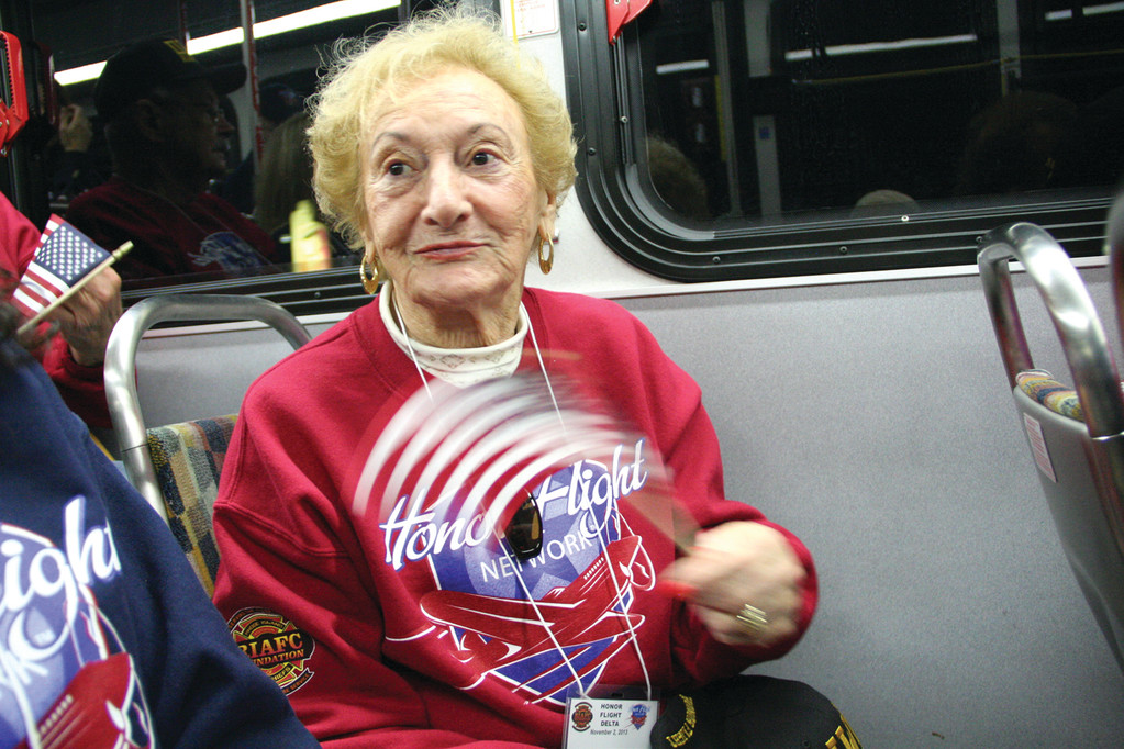 WAVING A FLAG: Gloria Lichtenstein, who served in the WAVES during World War II, was on Saturday�s Honor Flight.
