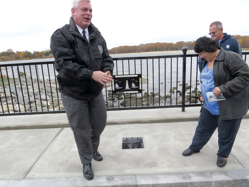 OFFICIAL NAMING: Mayor Scott Avedisian has a laugh after revealing a stone plaque on the sidewalk of the newly restored bridge, which reads �Danger Bridge 2013,� along with the city�s seal. City Council President Donna Travis fought furiously to convince Avedisian that was indeed the name of the bridge as she campaigned for its restoration.