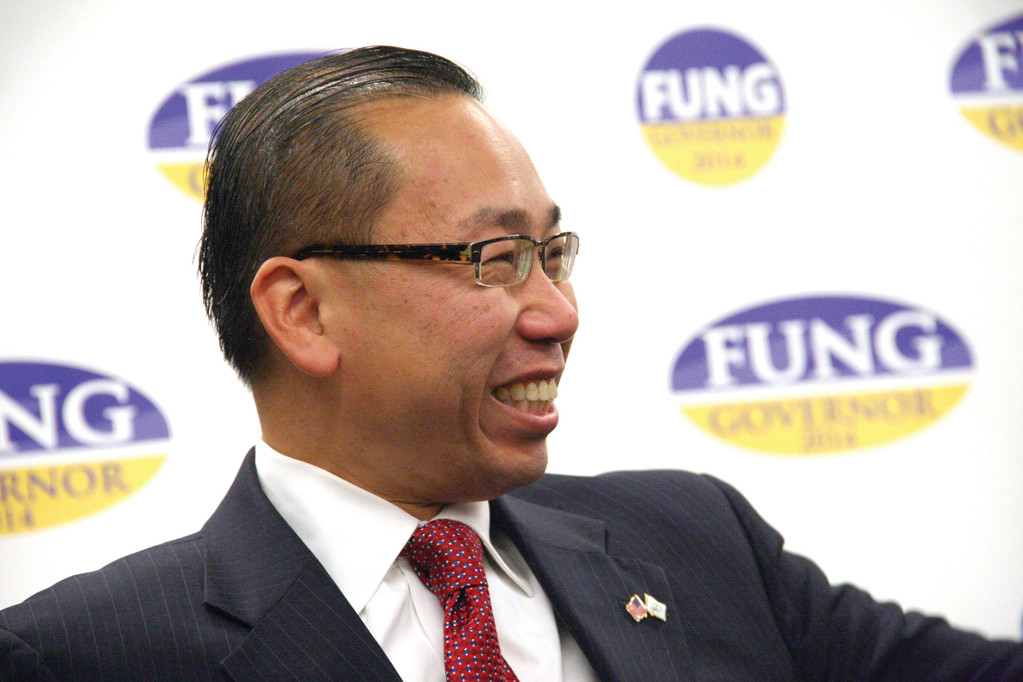 BASKING IN THE APPLAUSE: Mayor Fung acknowledges the applause of his supporters during his announcement Monday that he is a candidate for governor.