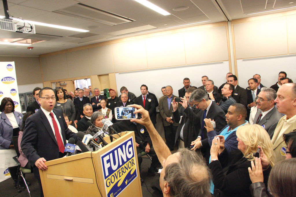 IT'S OFFICIAL: With his family at his side, Mayor Allan Fung declared he's a candidate for governor Monday morning at Taco Manufacturing.