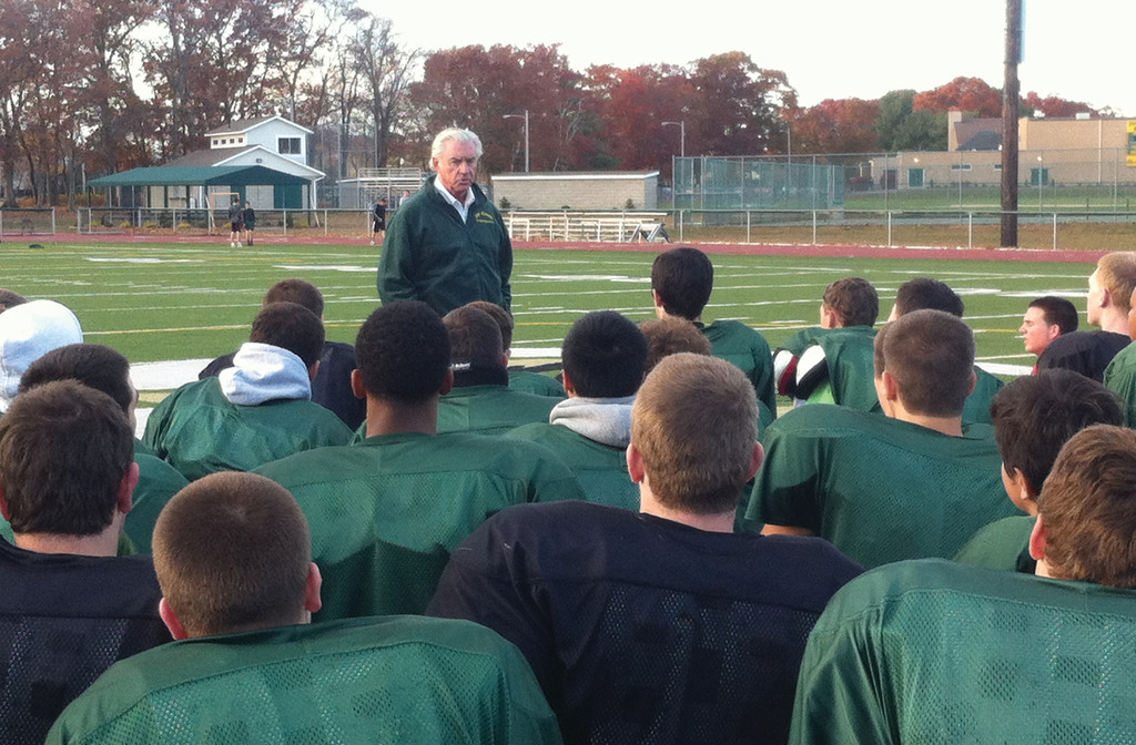 NFL PEP TALK: Hendricken alum and NFL executive A.J. Smith talks to the football team at practice on Wednesday.