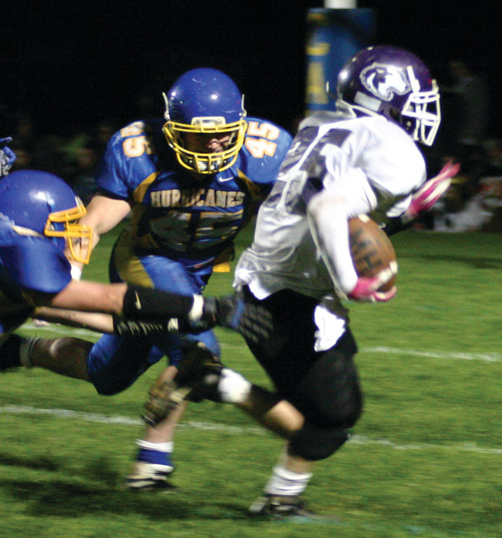 CHASING: Vets� David MacDonald tries to wrap up a Mt. Hope ball carrier in last year�s meeting between the teams.