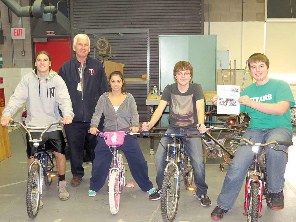 NEW SET OF WHEELS: Max Lupovitz, Technology Teacher Dennis Dubee, Sarah Sagnella, Kyle Gray and Michael DePardo make up the committee for Toll Gate High School's Bikes Not Bombs, a yearlong bike drive to provide jobs and transportation to people living in Africa.