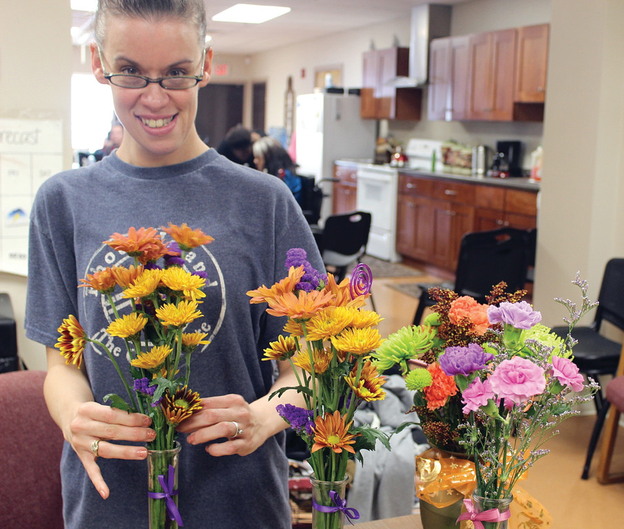 "PUSHING PETALS: West Bay Residential client Keri Hickey enjoys being a part of Petals, a program that gives her a chance to earn money, as well as engage with the local community. ""It's fun,"" she said."