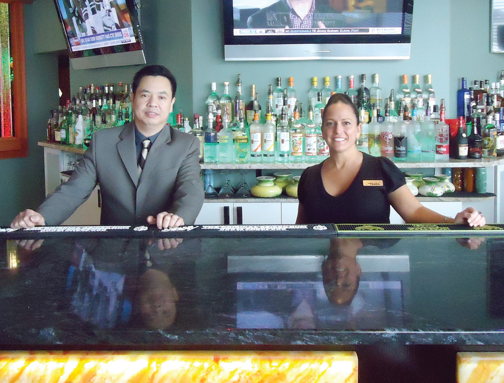 "WHAT WOULD YOU LIKE? Owner Shang Wang and bartender Tonia Cipolletta show off the newly updated bar facilities. ""Our customers love him. He's a great owner to work for,"" said Cipolleta. ""He makes sure that the service, food and drinks are consistent. He checks in on his customers and remembers them when they return."""
