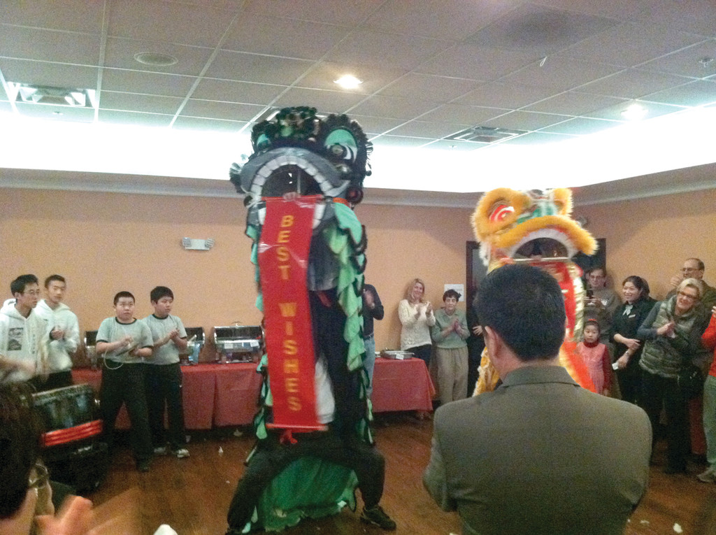 LION'S ROAR: The performers of the Rhode Island Kung Fu Club offered well wishes to Wang at his grand function room unveiling at Lemongrass.