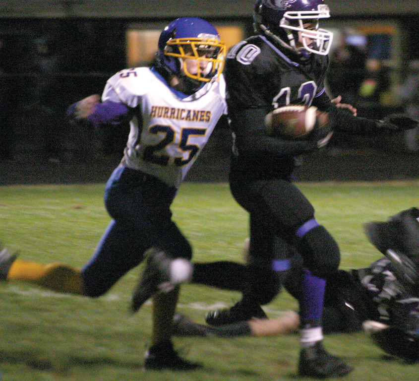 ONE STEP BACK: Kyle Agin chases Mt. Hope's Corey Jackson during the Huskies' 25-0 win over Vets on Friday