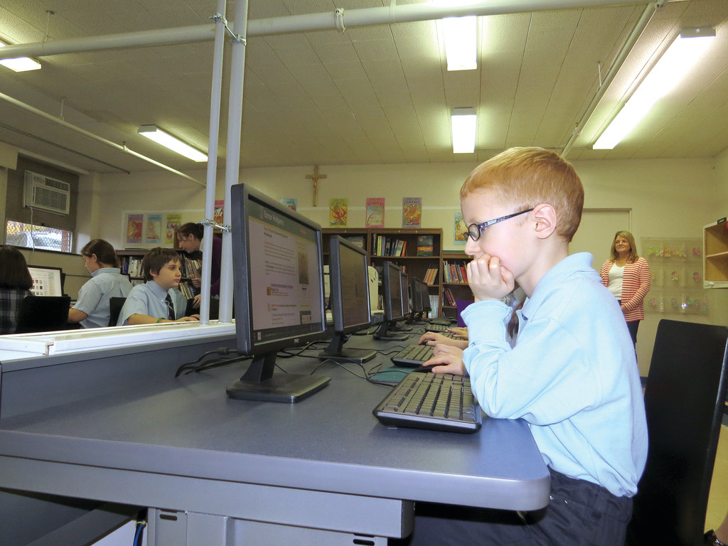 FUTURE TECH WIZ: Second grader Zachary Young shows parents and other guests how he is able to use the new computers to access learning sites and work on projects.