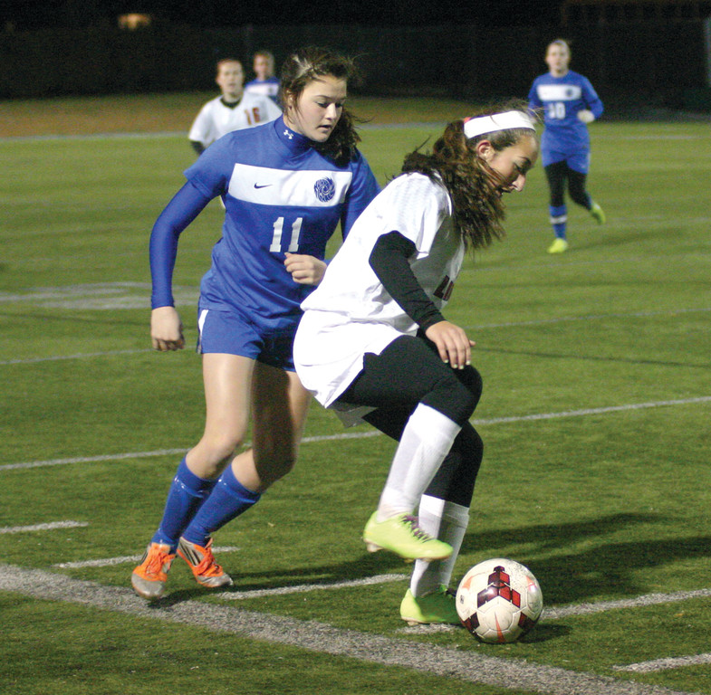 TOUGH TO HANDLE: Sloan Kinney covers Lincoln's Hailee Jarry on Friday night. Jarry scored both goals as Lincoln came back from a 1-0 deficit to win 2-1 for a spot in the Division II championship.