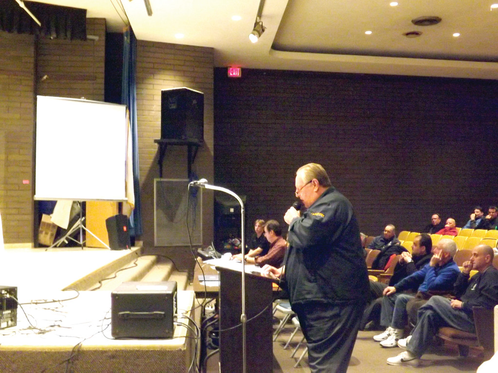 KEEPING IT LOCAL, GETTING IT DONE: Arthur Jordan of Local 1322 presents a PowerPoint on the importance of keeping the bus drivers as Cranston employees at a School Committee work session on Nov. 5.