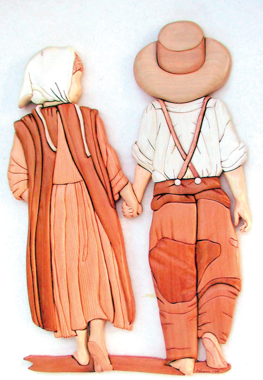 AMIABLE AMISH: An Amish boy and girl walking on a country road was an ideal subject for an intarsia project. The wood was carefully selected and placed to complement the design.
