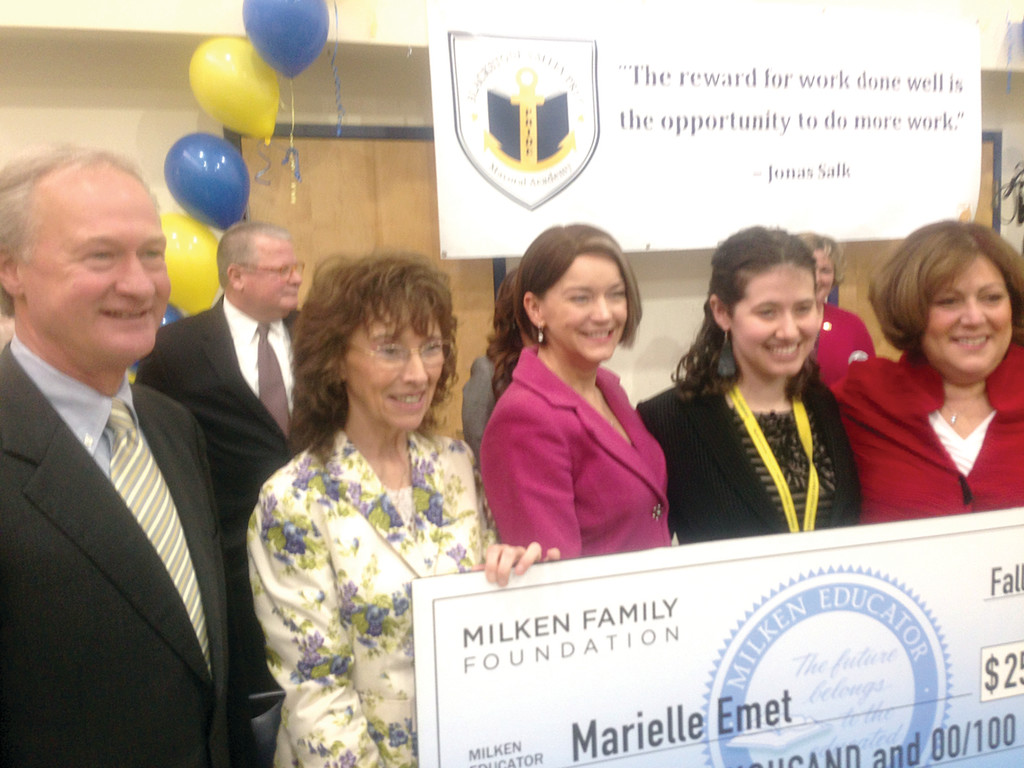 A SURPRISING AWARD: Governor Lincoln Chafee, Senior Vice President of Milken Educator Awards Jane Foley, Education Commissioner Deborah Gist, 2013 Milken Educator Award Winner Marielle Emet and Board of Education Chairwoman Eva-Marie Mancuso pose for a photo during last Friday�s surprise award ceremony at Blackstone Valley Prep Mayoral Academy in Lincoln.