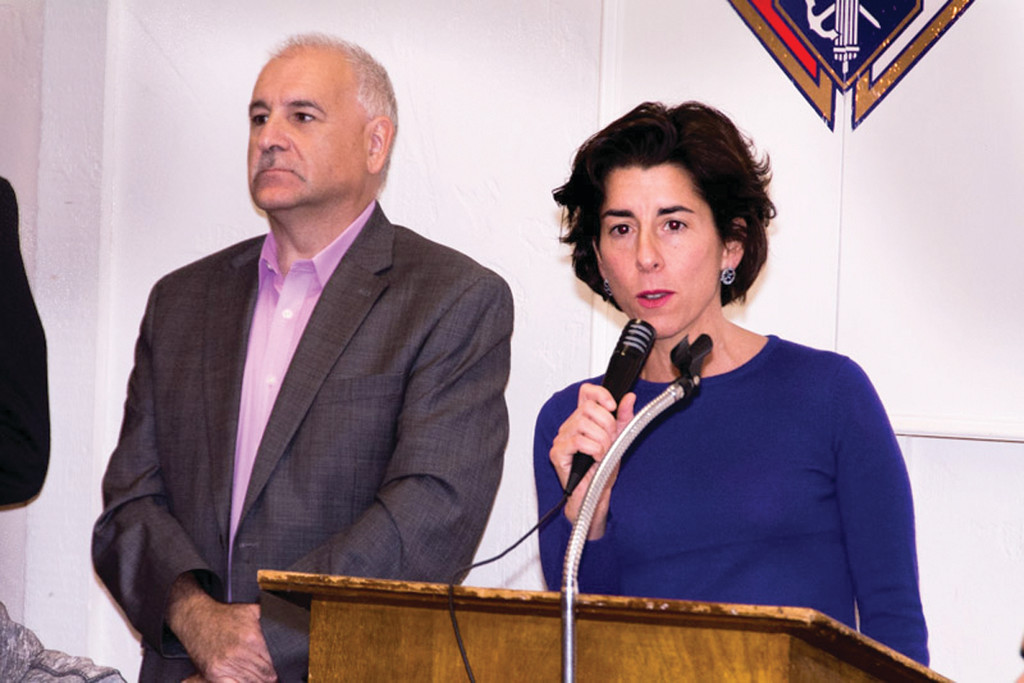 Treasurer Gina Raimondo, speaking at the Nov. 10 Johnston Democratic Town Committee Breakfast alongside Johnston Mayor Joseph Polisena.