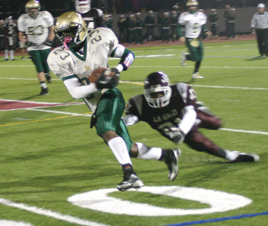 BREAKING AWAY: Hendricken's Lee Moses gets loose on what eventually became a 53-yard touchdown in Friday's game with La Salle. The score put the Hawks ahead 27-22, and they held on from there.