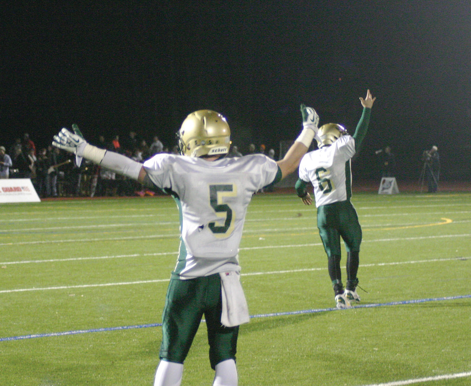 FINISHING TOUCH: Hendricken's Mitch Lucci (5) and Patrick Gill celebrate after a late touchdown by Lee Moses gave Hendricken the lead on Friday .