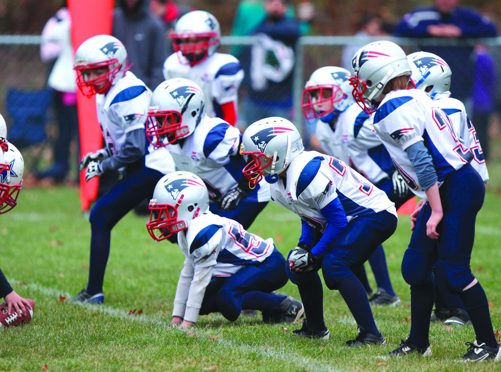 The Warwick PAL Junior Pee Wee defense gets set for the snap during Sunday�s regional game. The defense turned in a shutout in a 14-0 win.