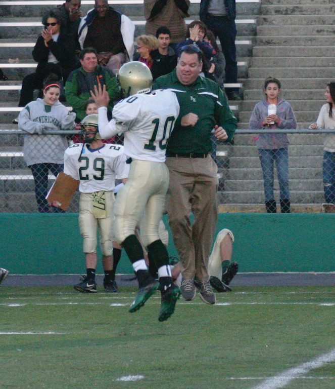IN THE BOOKS: Hendricken freshman quarterback Chris Hindle and head coach Jonathan Stringfellow celebrate in the air late in Hendricken�s 38-22 victory over La Salle in the freshman Super Bowl on Saturday.