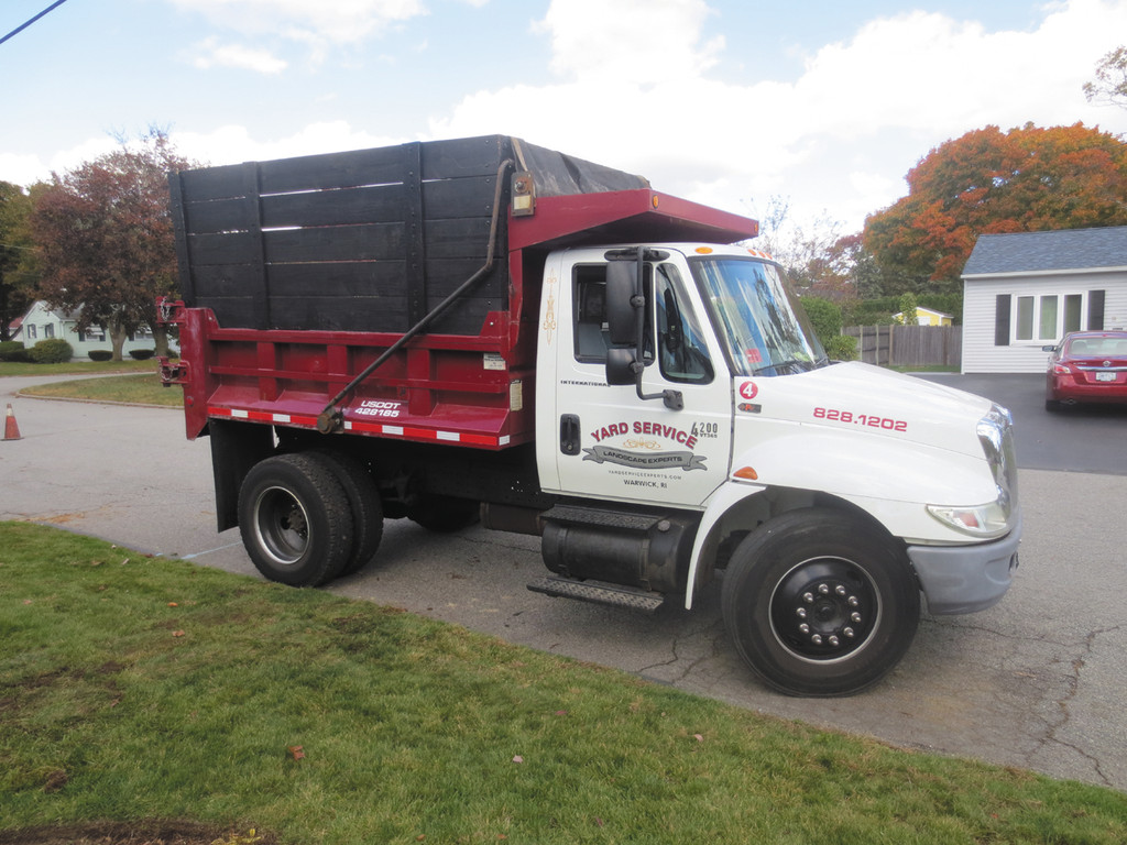 Look for the signature work truck of Yard Service Landscaping Experts, Inc. in your neighborhood - always accepting new customers.