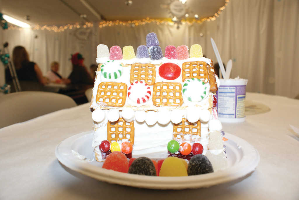 HOW SWEET IT IS: Pictured is just one of the thousands of gingerbread houses made at the Artists' Exchange during the annual Gingerbread Decorating Contest. This year's contest will be held on Dec. 7 and the entire family is invited to come, create and celebrate.