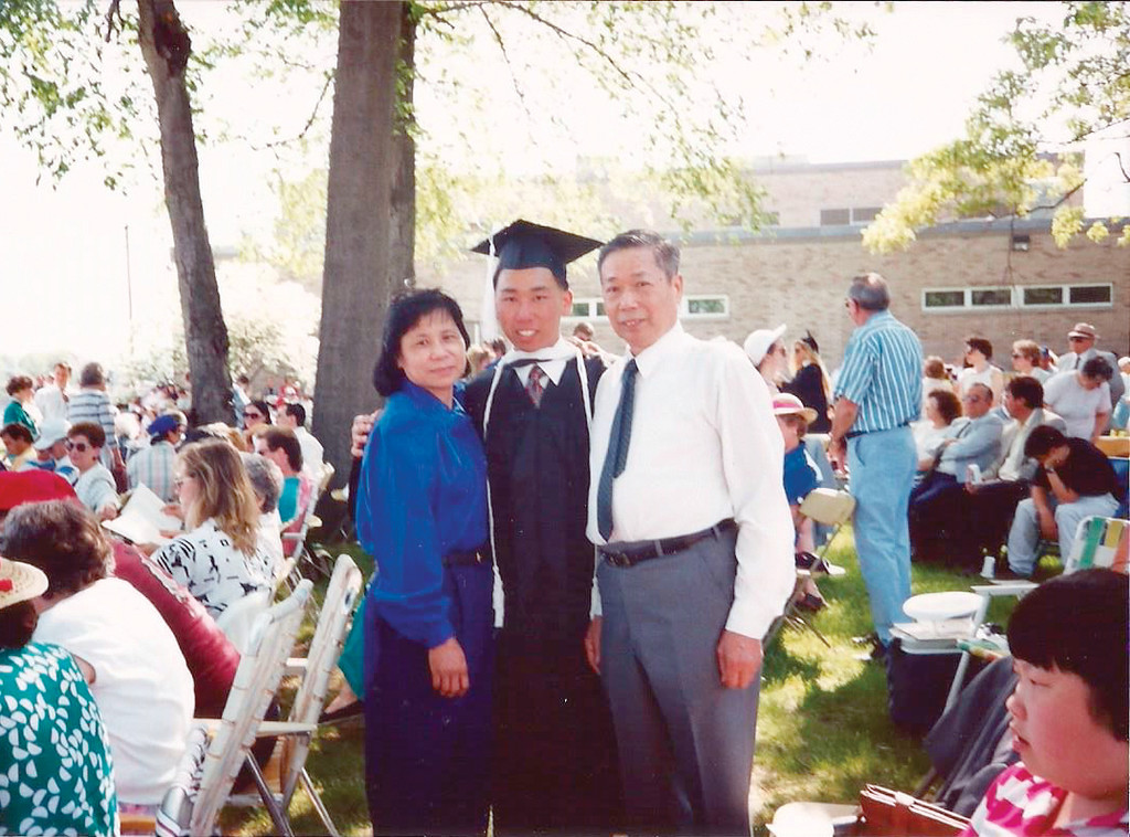 ON HIS WAY: Fung, pictured with his parents, graduated from Rhode Island College with a degree in Political Science in 1992.