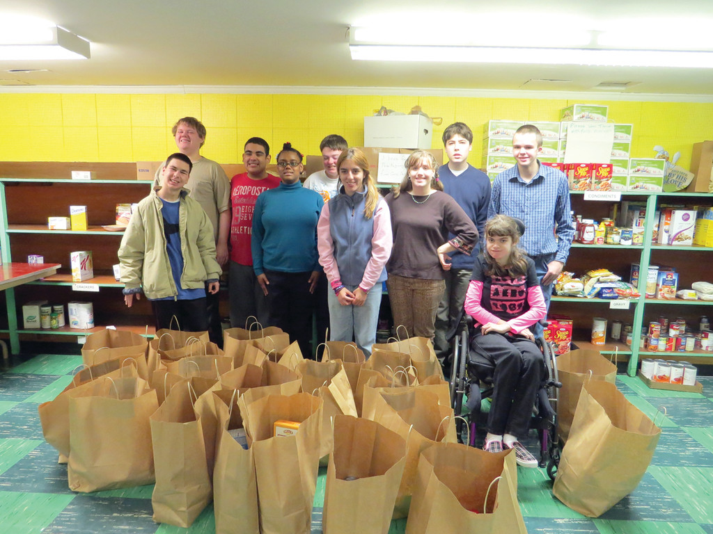 A JOB WELL DONE: Ten students from the Toll Gate High School Special Education Department visited the food pantry at St. Peter Church to fill 50 bags with food for the Church's St. Vincent de Paul Society. The bags will be given to Warwick's Neighbors Helping Neighbors program, Providence's St. Patrick's Parish, Providence's Assumption Parish and people in need who call the program for help.