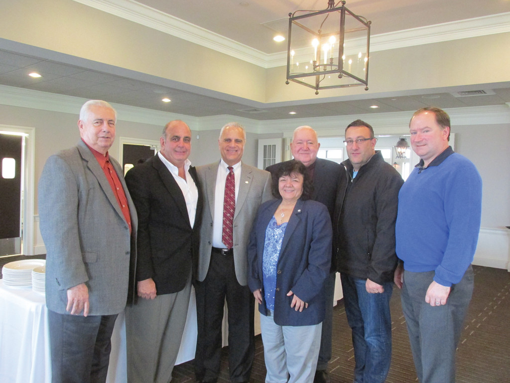 IN SUPPORT: Among the many Warwick political leaders who turned out Sunday at Harbor Lights Country Club and Marina to support City Councilman Ed Ladoucoeur at a special fundraising breakfast are, from left: council members Joseph Gallucci, Joseph Solomon, Donna Travis, Steve Merolla and State Sen. Mike McCaffrey.