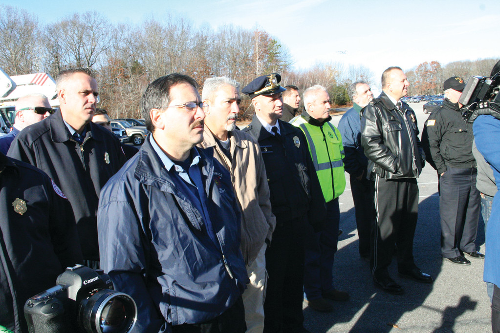 KEEPING THEIR DISTANCE: Fire and police officials from across the state watch the demonstration at CCRI yesterday.