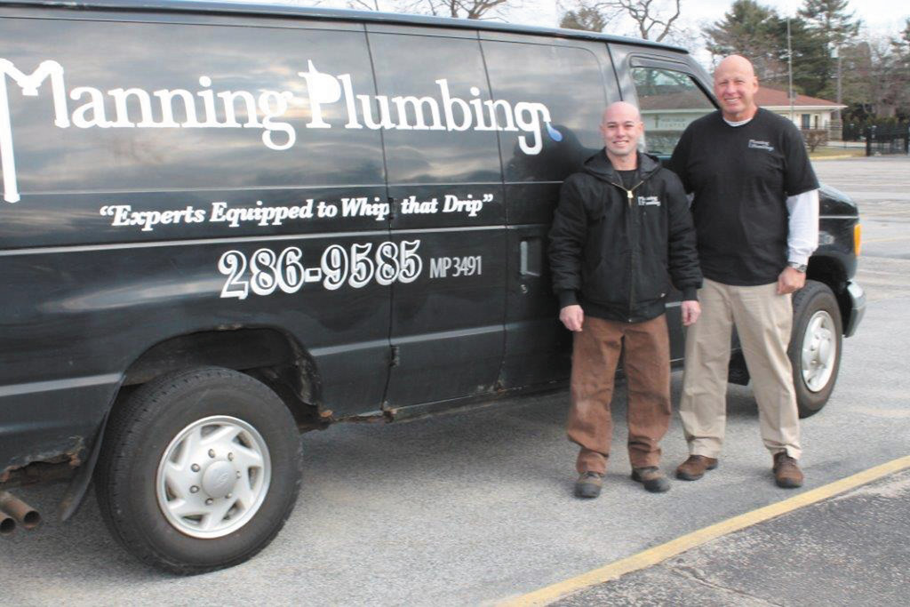 Mike and business partner Chet stand in front of Manning Plumbing's signature black van and warn homeowners against frozen pipes this winter.