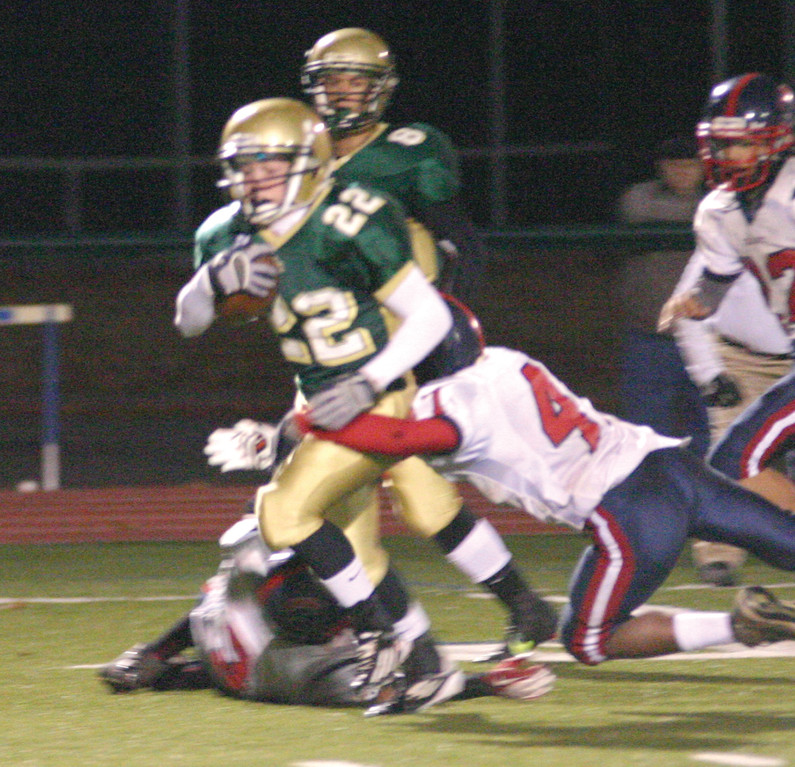 A YEAR AGO: Hendricken running back Remington Blue breaks away from a Toll Gate defender.