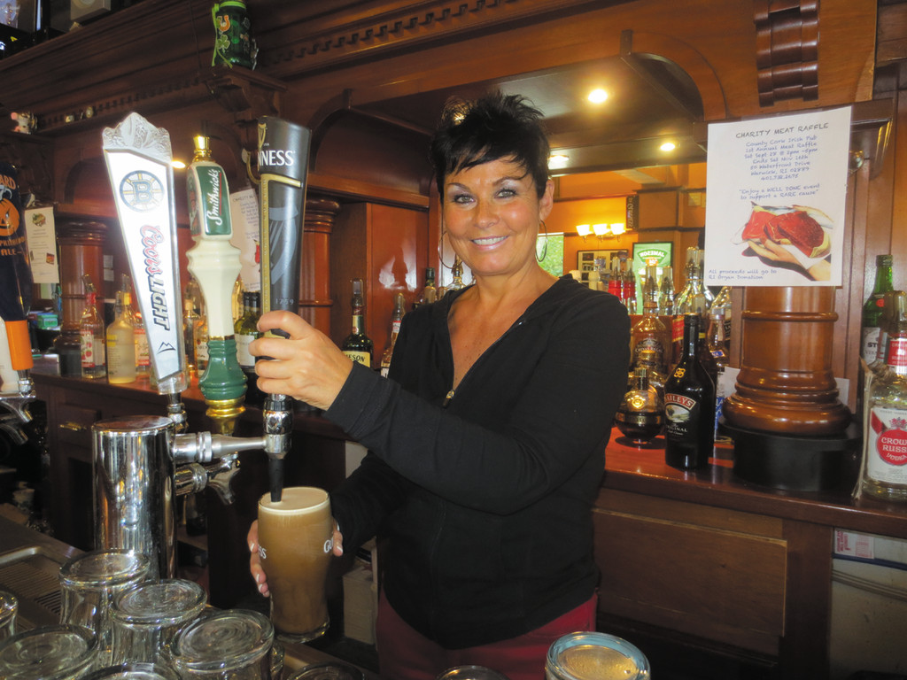 Cora McAuliffe pours a 20 oz. Imperial Guinness and prepares for another busy night at her County Cork Irish Pub in Warwick.