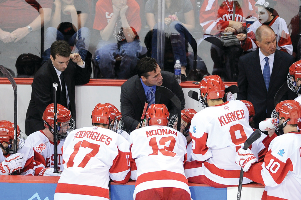 AT THE HELM: Cranston native David Quinn talks to his Boston University hockey team earlier this season. Quinn, a BU grad, is in his first season as the head coach of the Terriers.