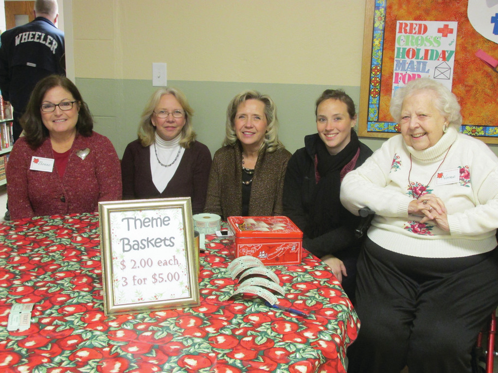 IN CHARGE OF RAFFLES: Bonne Simonian (left), who chaired the raffles during last Saturday's St. Barnabas Bazaar, joins another three-generation family that volunteered to man the Theme Baskets booth. The group includes, second left: Kathy Richardson, Karen Thornton, Erin Hus and Norma Barker.