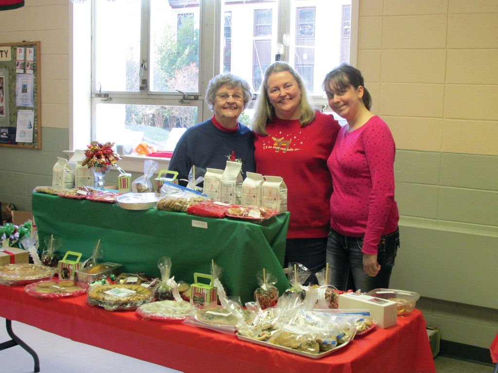 TEAMING UP: One of three family generation teams that helped make the St. Barnabas Bazaar a huge success last Saturday includes, from left: Eleanor Menzies, Marion Menzies and Michela Lombari. These lades manned the home-baked table.