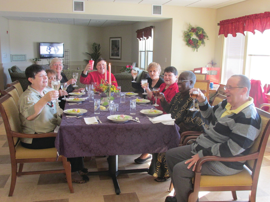 TOASTING THE DAY: Residents at Saint Elizabeth Terrace toast each other at the outset of their cooperative Thanksgiving dinner Thursday afternoon. The group includes, counter clockwise: Sheila Sousa, Flora Papa, Jean Walsh, Allison Gil, Jill Mancini, Mary Gill and Charlie Ribidou.