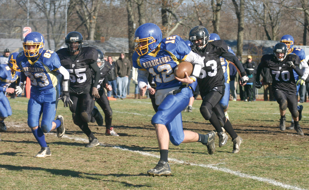 ON THE LOOSE: Vets quarterback Jesse Sedoma hits the edge on a 97-yard touchdown run that gave Vets a 22-0 lead in the annual Thanksgiving game with Pilgrim. The 'Canes won 44-0, establishing a new record for largest margin of victory for the second year in a row.
