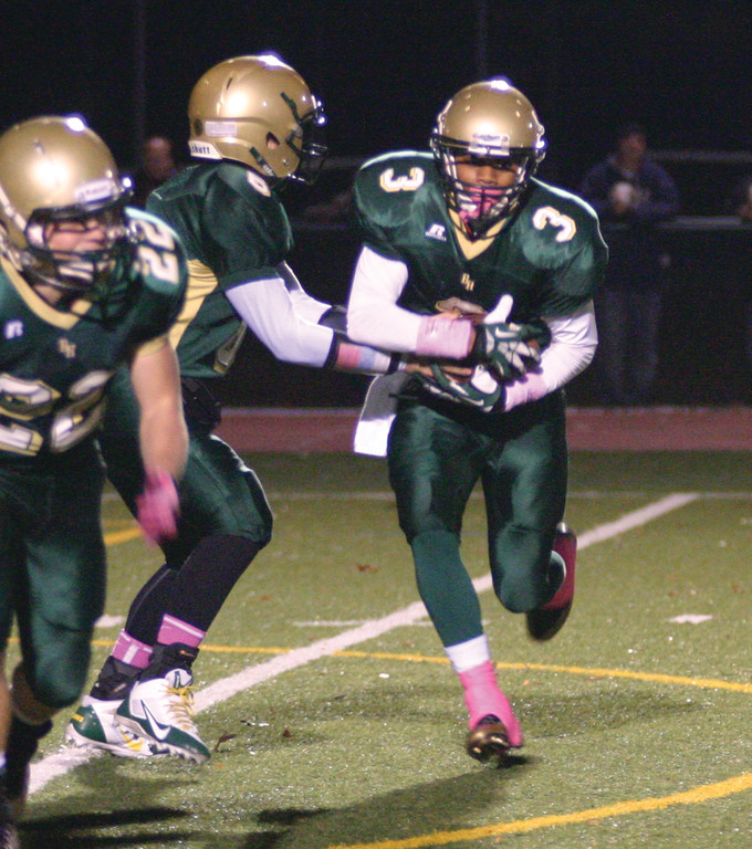 GROUND GAME: Matt Duffie takes a handoff in Hendricken�s regular season win over Portsmouth.