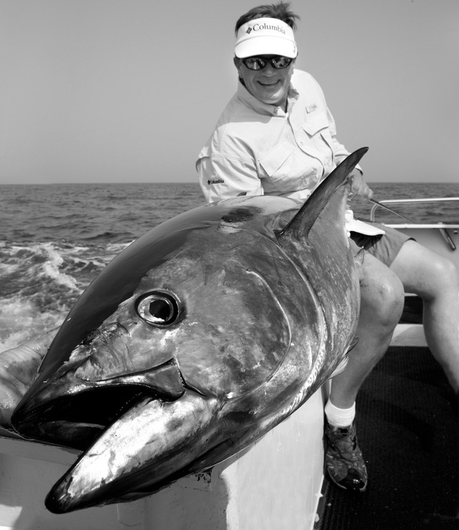 From bottom fish to bluefin tuna: Tickets to the Saltwater Sportsman's national seminar series with host George Poveromo (shown with bluefin tuna) make a great holiday gift for the angler.