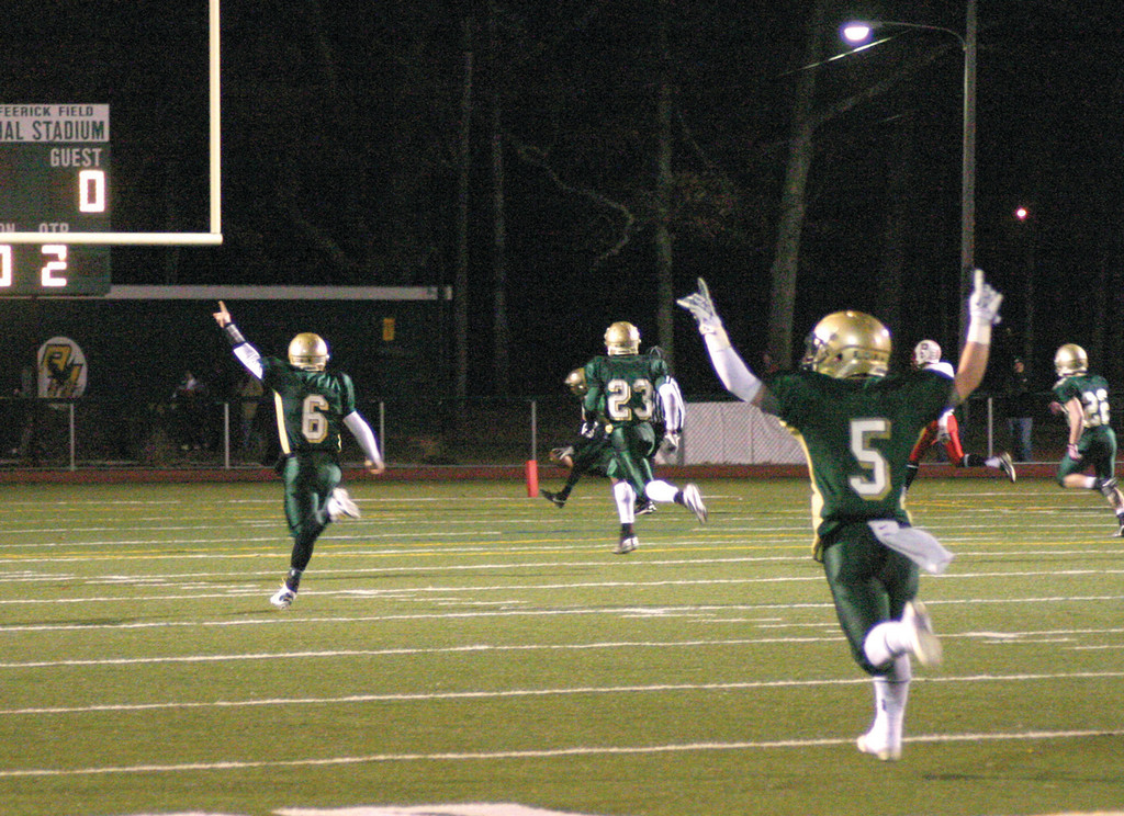 SUPER BOWL RUN: Hendricken's Patrick Gill, Lee Moses and Mitch Lucci celebrate as they follow Mike Scarcella to the end zone on a long touchdown in Tuesday's semifinal game. The Hawks beat Portsmouth for a spot in the Super Bowl, where they'll try for their fourth straight title.