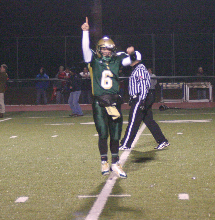 ONE TO GO: Hendricken quarterback Patrick Gill celebrates a touchdown in Tuesday�s win over Portsmouth.