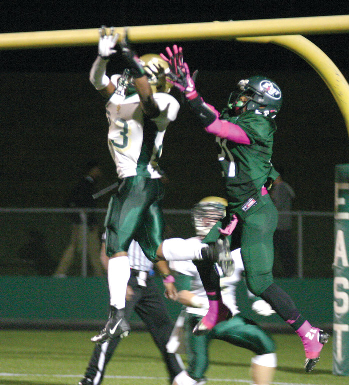 Lee Moses and Marquem Monroe rise for the ball in the regular season meeting between Hendricken and East.